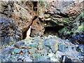 NO9091 : N entrance to cave on Grum Briggs by Nigel Feilden