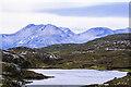 NH0464 : Un-named lochan on south slope of Beinn a' Mhùinidh by Trevor Littlewood