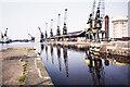 SE7423 : Dockside cranes on north side of West Dock, 1980 by Trevor Littlewood