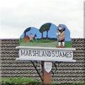 TF5209 : Marshland St James village sign by Adrian S Pye