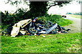 ST7981 : Fly Tipping, Old Down Road, Badminton, Gloucestershire 2000 by Ray Bird