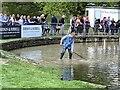 SK2570 : Fence judge raking moat at Chatsworth Horse Trials by Jonathan Hutchins