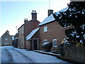 TF1606 : Chestnut Close, Peakirk, in the snow by Paul Bryan
