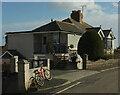 SX8964 : Bike and house, Burridge Road by Derek Harper