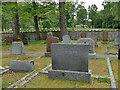NH5052 : Urray church, Knox-Johnston grave by Stephen Craven