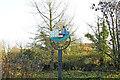 TG2223 : Brampton village sign (old) by Adrian S Pye