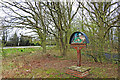 TF6916 : East Winch and West Bilney village sign by Adrian S Pye