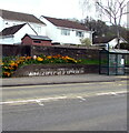 ST4287 : Colourful bank above the B4245 Main Road, Undy, Monmouthshire by Jaggery
