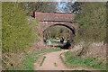 SO8074 : Railway bridge over a bridleway by Chris Allen