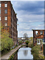SJ8598 : Ashton Canal passing Brunswick Mill by David Dixon