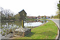 TF8037 : Stanhoe village sign and pond by Adrian S Pye