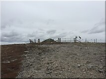 NH7719 : Carn Dubh Ic An Deoir Trig Point, Cairn and Solar Panel for Electric Fence by thejackrustles