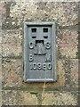 NY1953 : Flush bracket benchmark, Sleightholme Railway Bridge by Adrian Taylor