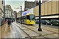 SJ8498 : Metrolink Tram on High Street by David Dixon