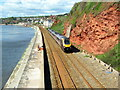 SX9777 : Cross Country train about to pass under footbridge near Dawlish by Roy Hughes