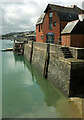 SW9275 : Harbour wall and warehouse, Padstow by Derek Harper