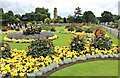 TQ1877 : Flower beds in front of The Palm House, Kew Gardens by Martin Tester