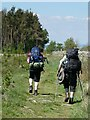 NY9768 : Heavily laden trail walkers by Oliver Dixon