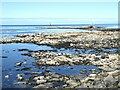 NK0365 : Rocky shore north of Cairnbulg Harbour by Oliver Dixon