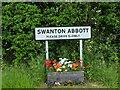 TG2726 : Swanton Abbott Village Road Sign by David Pashley