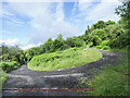 NN8249 : Hairpin bend at junction on hill road above Camserney by Trevor Littlewood