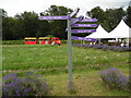 TQ2761 : Signpost and train at Mayfield Lavender Farm (2) by David Hillas