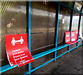 ST1876 : Social distancing notices in a passenger shelter on Cardiff Queen Street station by Jaggery