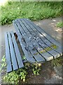 NZ2054 : Wrecked picnic table by Oliver Dixon