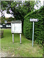 TL8637 : Henny Village Notice Board & roadsign by Geographer