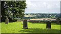 NZ1230 : East side of graveyard at St. James Church by Trevor Littlewood