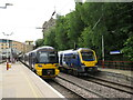 SE1633 : Trains at Bradford Forster Square by Malc McDonald