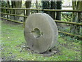 TM3154 : Millstone on the verge at Loudham Mill by Adrian S Pye