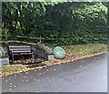 ST3398 : Bench between flowers, Coed-y-Paen, Monmouthshire by Jaggery
