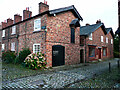 SJ8383 : Warehouse and shop, Oak Cottages, Styal by Humphrey Bolton