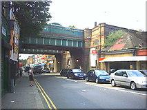 TQ2673 : Twin railway bridges over Garratt Lane at Earlsfield Station. by Noel Foster