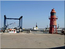 TQ6674 : Lighthouse & Jetty by Glyn Baker