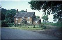 SJ8021 : Cottage near Shelmore Wood by Andrew Longton