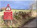 NY6043 : Warning sign and farmland near Renwick by Andrew Smith