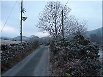 SH6028 : Lane at Pen-y-bont on the way to Cwm Bychan by John Lucas