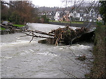 NY2623 : Remains of the footbridge over the river Greta by Richard Swales
