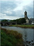 NT2540 : Parish church and wishing well viewed from the banks of the River Tweed by Caz