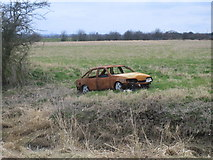 SK8166 : Burnt out car, Smithy Marsh by Matthew Smith