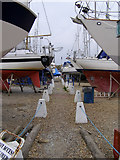 SZ3394 : Solent Way footpath through the boatyard, Waterford by Jim Champion