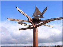 NX3343 : Signpost at Port William by Oliver Dixon