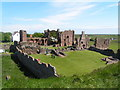 NU1241 : Ruins of Lindisfarne Priory & St Aidan's statue by N Chadwick