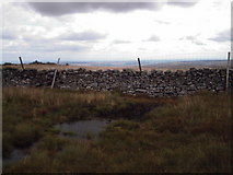 SE0076 : Pond on broad ridge between Little Whernside and Great Whernside by Bill Griffiths