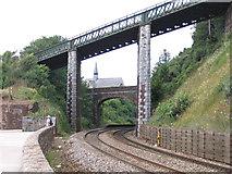 SX9473 : Railway, bridges and church by Stephen Craven