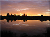 NZ3262 : Sunrise over the Lakeside fishery, 6:32am by P Glenwright