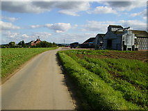SE7675 : Farm buildings on country lane at Riverdene, Great Habton by Phil Catterall