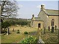 NZ0182 : St Wilfrid's Kirkharle in Spring by P Glenwright